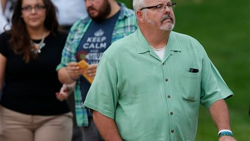 File--In this Friday, Aug. 7, 2015, file photograph, Tom Sullivan, who lost his son in the massacre at an Aurora, Colo., theatre in July 2012, leaves the Arapahoe County Courthouse after the jury sentenced convicted theatre shooter James Holmes to life in prison without parole in Centennial, Colo. Tom Sullivan launched his run to seek a seat in the Colorado State Senate in a heavily-Republican district on Tuesday, Feb. 23, 2016. (AP Photo/David Zalubowski, file)