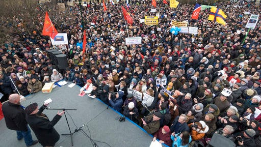 People rally to protest against the decision of the city authorities to hand over the city's landmark St. Isaac's Cathedral to the Russian Orthodox Church in St.Petersburg, Russia, Saturday, March 18, 2017. About four thousand people gathered for a protest against the controversial return of the renowned cathedral to the Russian Orthodox Church.