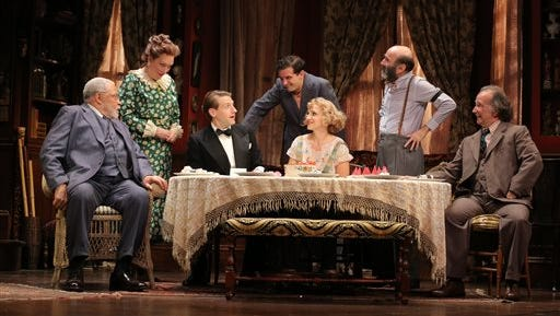 """In this image released by Jeffrey Richards Associates, James Earl Jones, from left, Kristine Nielsen, Fran Kranz, Reg Rogers, Annaleigh Ashford, Patrick Kerr and Mark Linn-Baker appear in a scene from """"You Can?t Take It With You,"""" performing at the Longacre Theatre in New York."""