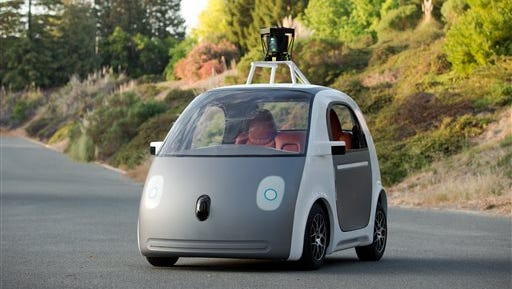 This image provided by Google shows a very early version of Google's prototype self-driving car. The two-seater won't be sold publicly, but Google on Tuesday, May 27, 2014 said it hopes by this time next year, 100 prototypes will be on public roads.