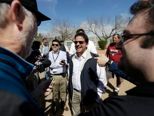 Milwaukee Brewers owner Mark Attanasio smiles as he talks to reporters during a spring training baseball workout Thursday, Feb. 26, 2015, in Phoenix. (AP Photo/Morry Gash)
