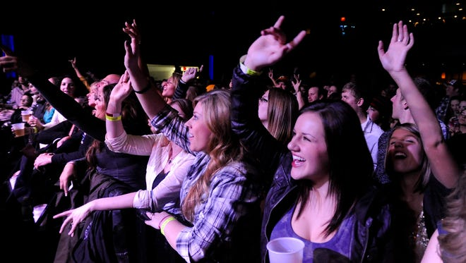 Fans cheer during the Kip Moore concert in December 2013.