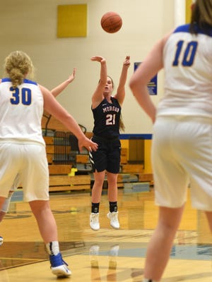 Morgan's Kaylie Apperson sinks a 3-pointer last season against Philo. Apperson returns to lead a veteran Raider contingent in their quest to make a lasting imprint in 2018-19.