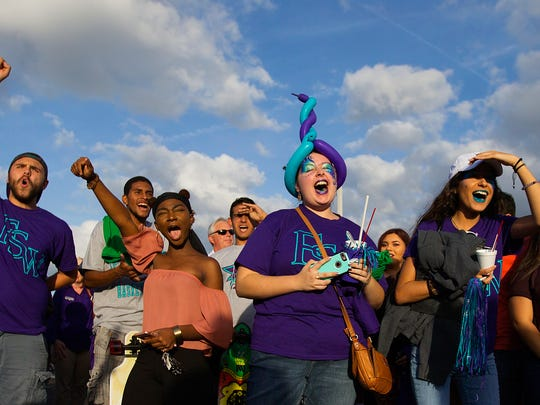 Florida Southwestern State College fans celebrate the opening of FSW's new arena Tuesday, Nov. 29, 2016, in Fort Myers.