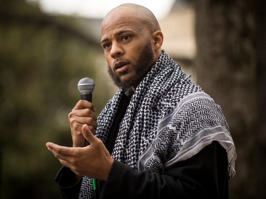 Andre Canty speaks during a rally calling on the sheriff