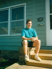 Tom O'Neill is shown in 1997 in front of the house