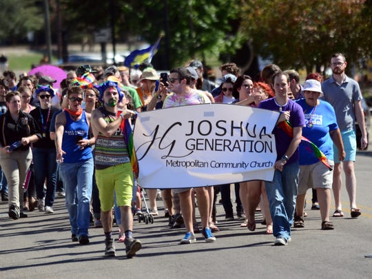 Joshua Generation church members march in the second annual Hattiesburg Unified Southern Fried Pride parade at Town Square Park.