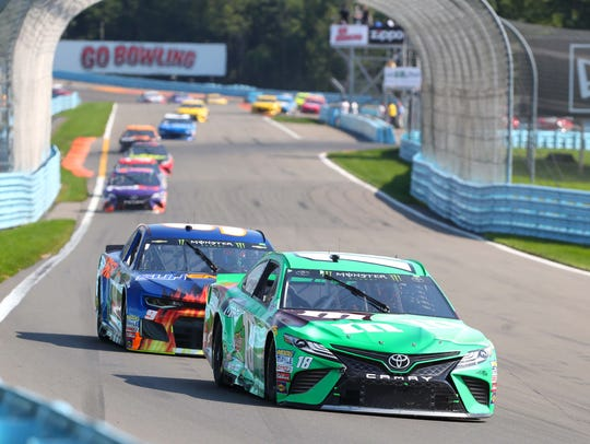 NASCAR Cup Series drivers Kyle Busch (18) and Chase Elliott (9) compete in the 2018 Go Bowling at the Glen at Watkins Glen International.