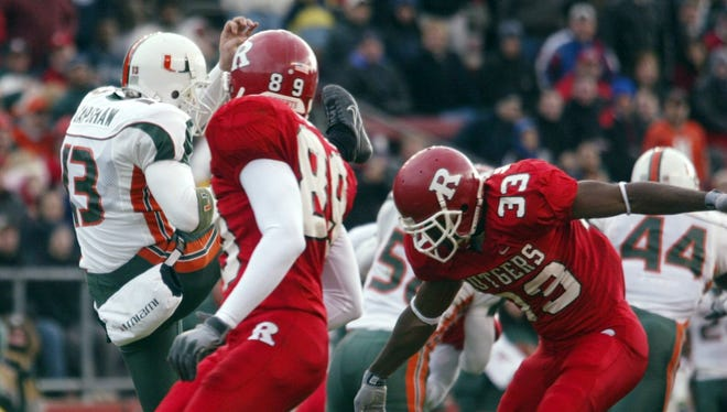 Jason Nugent (33) blocks a  punt that leads to a touchdown for Rutgers in a 2002 game vs. Miami.