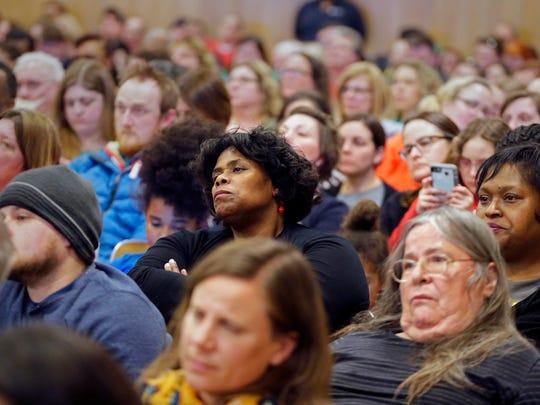 Skeptical MPS teachers and concerned parents listen