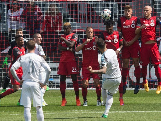 Minnesota United FC's defender Francisco Calvo (5) sends a free kick over Toronto FC's wall but also over the crossbar  during the first half of an MLS soccer game in Toronto on Saturday, May 13, 2017. (Chris Young/The Canadian Press via AP)
