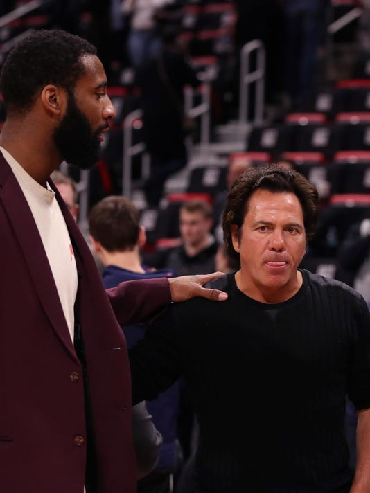Detroit Pistons center Andre Drummond, left, meets with team owner Tom Gores after an NBA basketball game against the Toronto Raptors, Monday, April 9, 2018, in Detroit. Drummond did not play due to a sore Achilles tendon. (AP Photo/Carlos Osorio)