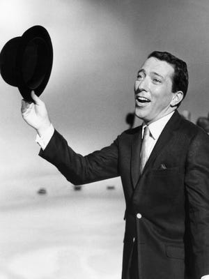 "In a May 12, 1961 file photo, Andy Williams performs a song on a television show. Williams was known as ""Mr. Christmas"" in part for the success of his song, ""It's the Most Wonderful Time of the Year,"" released in 1963 on the first of his eight Christmas albums."