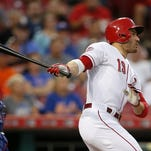Reds first baseman Joey Votto (19) singles in the bottom of the first inning during the MLB game between the New York Mets and the Cincinnati Reds, Thursday, Sept. 24, 2015, at Great American Ball Park in Cincinnati, Ohio.