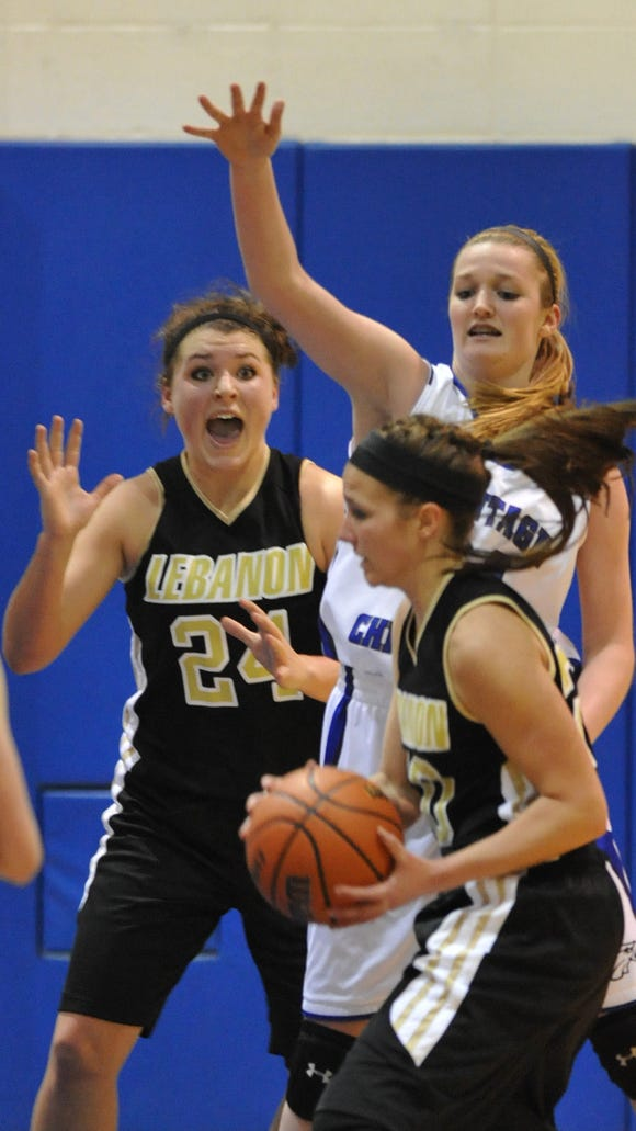 Heritage Christian's Allison Schofield tries to keep Lebanon's Aspen Davis from getting the ball to teammate Kristen Spolyar in third quarter action as Lebanon defeated Heritage Christian 48-47 at Heritage Christian Monday January 14, 2013.  Joe Vitti / The Star