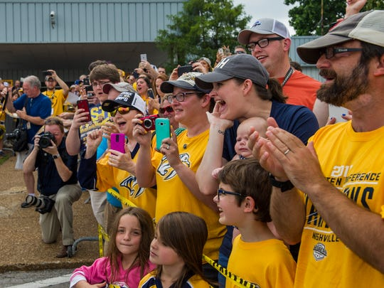Fans cheer as Nashville Predators players arrive at the Nashville International Airport in Nashville, Tenn., before the team travels to Pittsburgh for the beginning of the Stanley Cup Final Saturday, May 27, 2017.