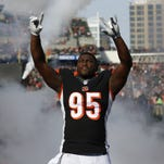 Bengals defensive end Wallace Gilberry heads out onto the field for player introductions prior to their 2014 game against the Steelers at Paul Brown Stadium.