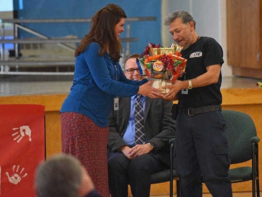 Tozer Elementary School janitor Rudy Hernandez receives