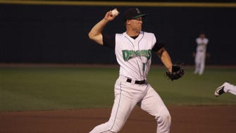 Reds prospect Nick Senzel fires a throw from third base in a recent game for the Low-A Dayton Dragons.