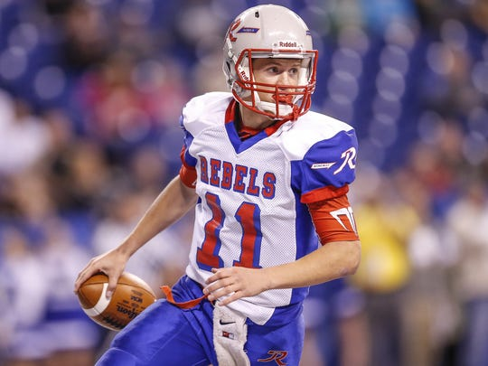 Roncalli Rebels quarterback Derek O'Connor (11) scores his third rushing touchdown of the game against the NorthWood Panthers in the Class 4A state title game at Lucas Oil Stadium on Friday, Nov. 25, 2016.