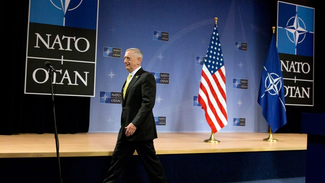 "U.S. Secretary of Defense Jim Mattis leaves after addressing a media conference at NATO headquarters in Brussels on Feb. 16. Mattis told NATO ministers that the alliance is ""a fundamental bedrock for the United States"" while at the same time demanding an increased financial commitment from the 27 other alliance members."