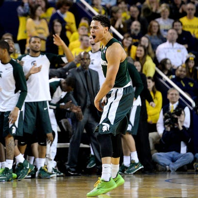 Spartans guard Bryn Forbes celebrates after hitting