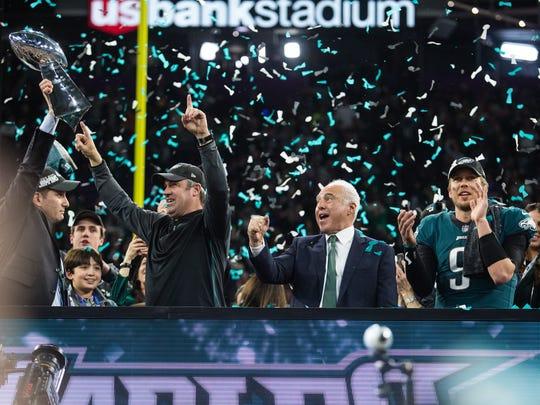 Philadelphia Eagles GM Howie Roseman, from left, head coach Doug Pederson, owner Jeffrey Lurie, and Super Bowl LII MVP Nick Foles celebrate winning Super Bowl LII Sunday at US Bank Stadium.
