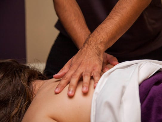 A customer gets a massage at Massage Envy in Chandler,