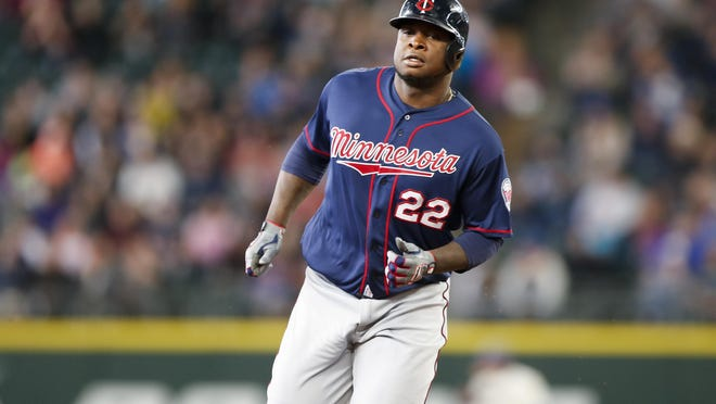 Minnesota Twins right fielder Miguel Sano (22) jogs around the bases after hitting a solo home run against the Seattle Mariners during the fourth inning at Safeco Field.