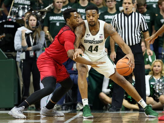 Michigan State Spartans forward Nick Ward (44) is defended