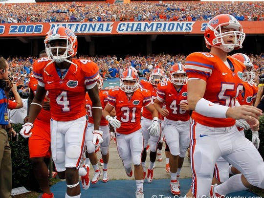 Brian Biada (31) runs out of the tunnel at the University of Florida's Ben Hill Griffin Stadium. Biada, a Gulf Coast grad, was a walk-on with the Gators from 2009-11.