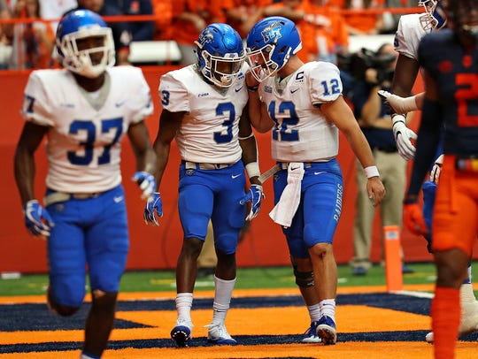 MTSU quarterback Brent Stockstill (12) and wide receiver Richie James (3) celebrate a touchdown during a win against Syracuse on Sept. 9.