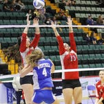 Kim Lavender goes up for the ball against Westhill on Saturday during a girls volleyball Class B pool-play semifinal match at Glens Falls Civic Center.