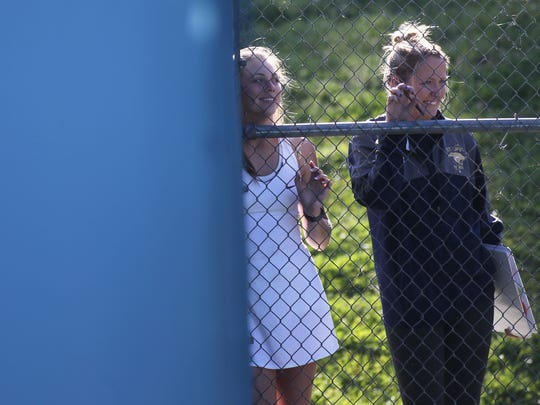 St. John Paul II coach Emily Serpico watches her team during a match at Tom Brown Park.