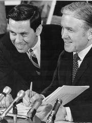 In this March 1969 photo, then-Mayor Dick Lugar (left), with then-Gov. Ed Whitcomb, signs the Unigov measure into law.