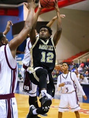 Bass field's Xavier Harper (12) shoots against Okolona during MHSAA Boys State Basketball Tournament quarterfinal action held in Jackson at the JSU Assembly Center.