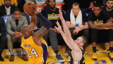 Los Angeles Lakers  forward Kobe Bryant (24) shoots against Utah Jazz forward Gordon Hayward (20) during the second half at Staples Center.
