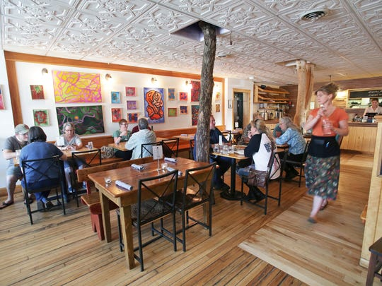 In this June 1, 2017 photo, customers sit for dinner at Driftless Cafe in Viroqua. This small town about two hours northwest of Madison is helping put Wisconsin on the culinary map.