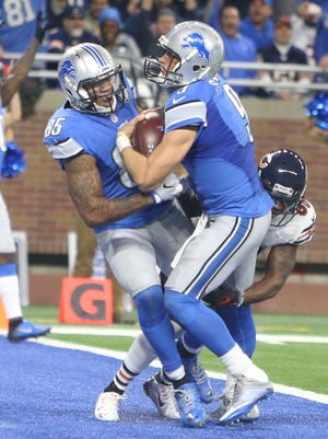 Lions quarterback Matthew Stafford scores the winning touchdown against the Chicago Bears on Sunday, Dec. 11, 2016 at Ford Field.
