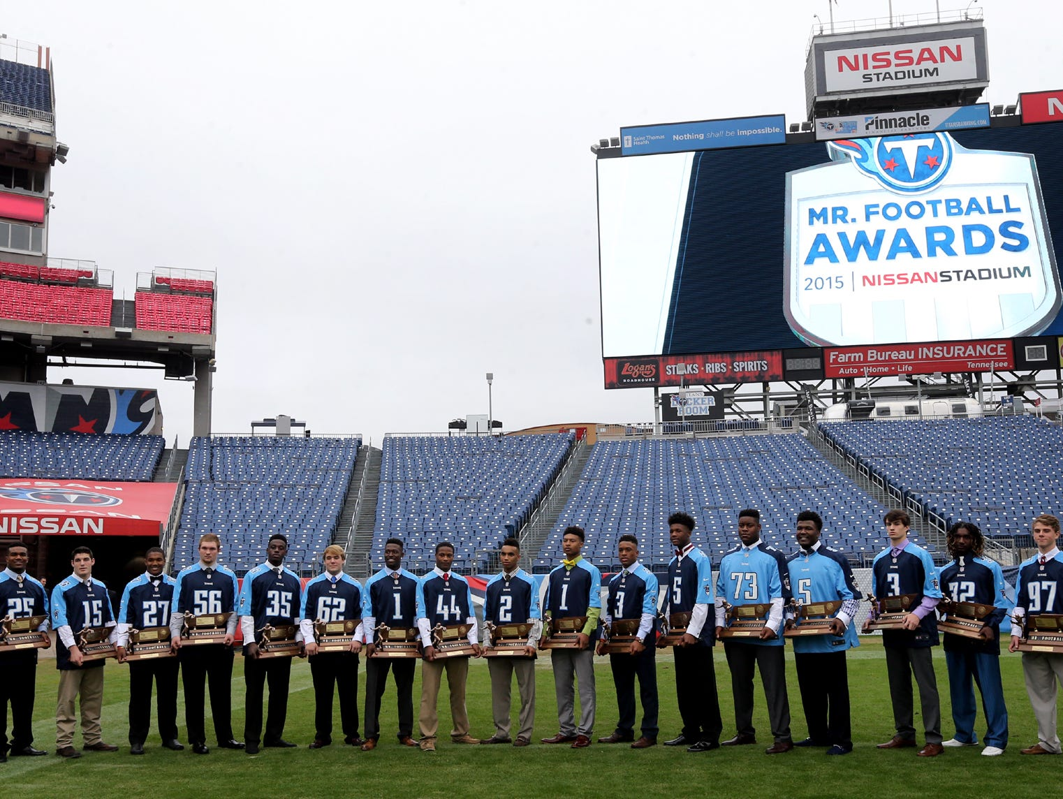 The 2015 Tennesseee Titatns Mr. Football Award winners on the Nissan Stadium Titans football field gather for an photograph after the ceremony Monday. The Mr. Football winners were given Titans jerseys with their High School number on the jersey.