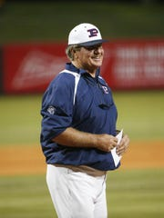 Pinnacle head coach Roy Muller prepares to exchange