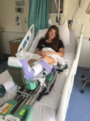 Spackenkill's McKenzie Dominick in her hospital bed a day after surgery on her hip in 2016.