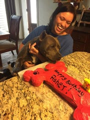 Anna Cupit helps Asher celebrate his birthday.