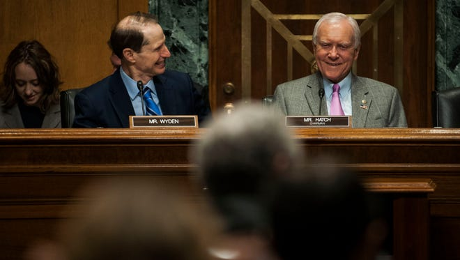 Chairman Orrin Hatch, right, speaks during a Senate Finance Committee hearing.