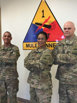 From left, Col.. James Jennings, Command Sgt. Maj. Pamela K. Williams and Staff Sgt. James Cannoy led the 1st Armored Division Sustainment Brigade's headquarters during its recent deployment to Afghanistan.