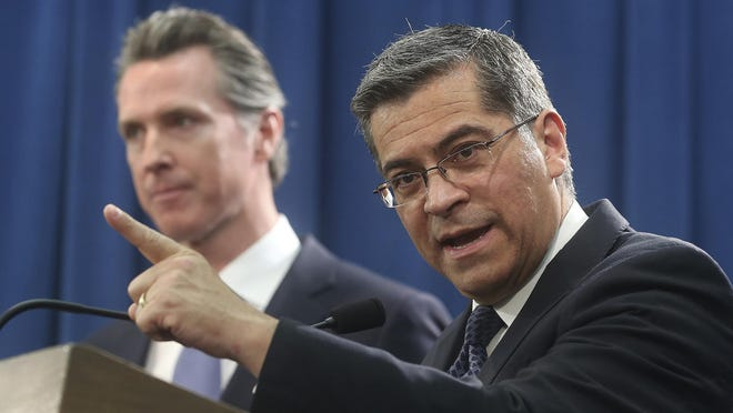 California Attorney General Xavier Becerra, right, accompanied by Gov. Gavin Newsom, filed a lawsuit Feb. 18 against Trump's emergency declaration to fund a wall on the U.S.-Mexico border.