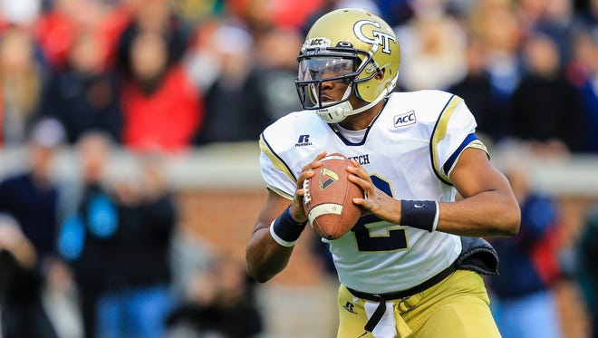 Georgia Tech Yellow Jackets quarterback Vad Lee drops back to pass in the first half against the Georgia Bulldogs at Bobby Dodd Stadium.
