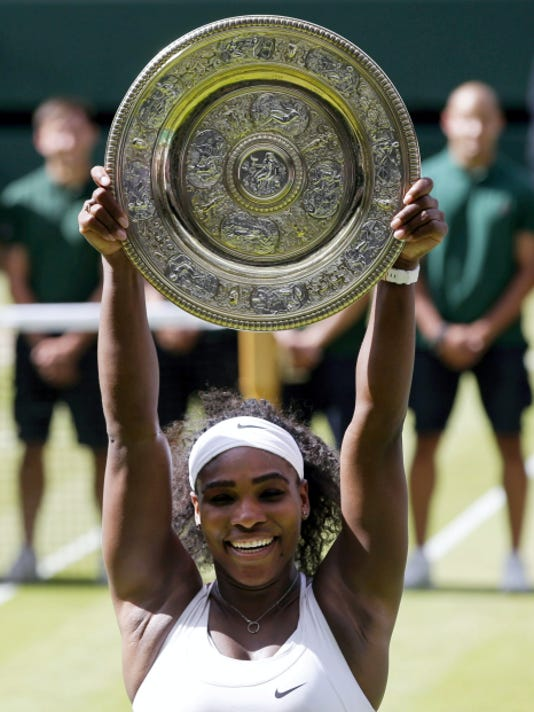 Serena Williams holds up the Wimbledon trophy — the Venus Rosewater Dish — after winning the women's singles final against Garbine Muguruza, 6-4, 6-4, at the All England Lawn Tennis Championships in Wimbledon, London, on Saturday. The victory gave Williams the second 'Serena Slam' of her career, where she holds all the Grand Slam titles at the same time.