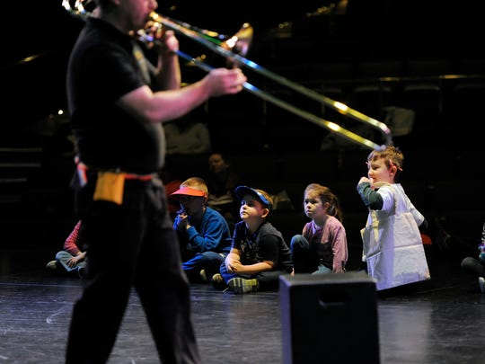 Tales and Scales performers Alex Wilkison, of Evansville, left, and Kensington Eck, of Newburgh, right, introduce themselves to children Saturday on stage during the Arts Smarts for Kids! event at the Henderson Community CollegeÕs Preston Art Center in Henderson, Saturday, Feb. 4, 2017. Tales & Scales presented their version of ÒThe Bremen Town Musicians,Ó one of the most popular fairytales by the Brothers Grimm.