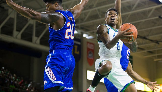Florida Gulf Coast University redshirt junior, Brandon Goodwin, goes up for a layup during the men's basketball home opener at Alico Arena in Fort Myers on Wednesday, November 16, 2016. Florida Gulf Coast University won the game against University of Texas at Arlington, 85 to 72.